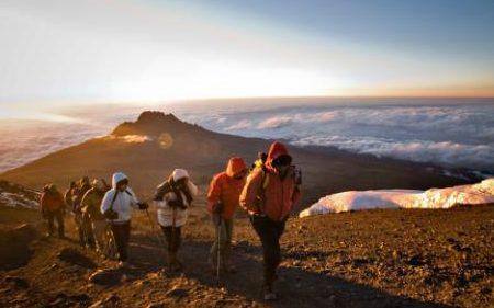Hiking-up-Mount-Kilimanjaro-large-xlarge_trans++SZCfQn3UNBPwFTCNOaG4IZrdAyC4X8LiP0eJDs56kOA